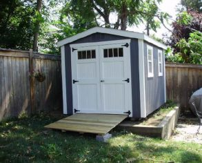 Dark Gable Shed with White Trim
