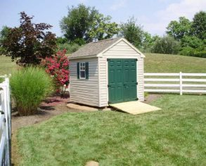 Beige Cape Cod Style Gable Shed with Green Doors